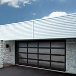 Modern Contemporary Garage Doors-Tinted glass Modern Garage Door in Oakville, Ontario by www.modern-doors