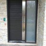 Modern Contemporary Custom Fiberglass Door with Stainless Steel Design-Modern Door available in Wood with horizontal strip installed in Toronto, Ontario by Modern-doors.ca