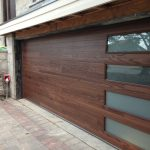 Custom Modern Contemporary Oversized Garage Door installed in custom new construction in Toronto