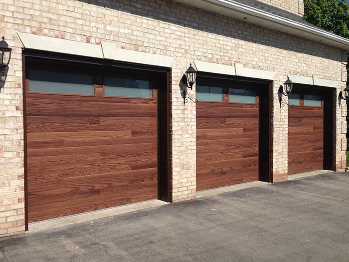 Modern woodgrain garage doors with 2 frosted windows for Wood grain garage doors