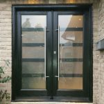 Modern Fiberglass Smooth Doors with Laser cut Door Lites and Stainless Steel Handles Installed in Newmarket
