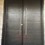 Modern Woodgrain Rustic Doors with Stainless Steel Handles installed in Toronto