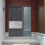 Modern Exterior Door with Stainless Steel bar Installed in Modern-Houme in Bathurst
