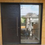 Fiberglass Woodgrain Single Modern Door with Clear Glass Door Lite installed by Modern Doors