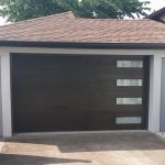 Modern Fiberglass Garage Woodgrain Door with 4 Frosted Door Lite installed by Modern Doors
