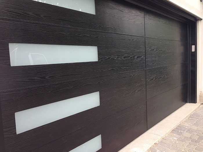Modern Garage Woodgrain Fiberglass Door With Door Lite Installed In Richmond Hill