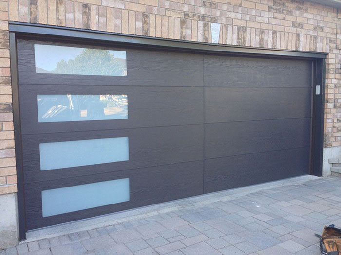 Modern Woodgrain Garage Door With Door Lites Installed In