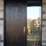Modern Fiberglass Rustic Door with Multipoint Lock and frosted side lite installed in Brampton