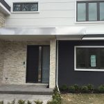 Modern Contemporary Fiberglass Door with Stainless Steel Design-Modern Door available in Wood with horizontal strip installed in Toronto, Ontario by Modern-doors.ca