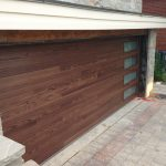 Custom Modern Contemporary Oversized Garage Door installed in custom new construction in Toronto by Modern-doors.ca