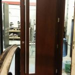 Modern Fiberglass Woodgrain Stained Door with tiny Door Lite and Multi Point Locks with Stainless Steel Handle manufactured by modern-doors.ca