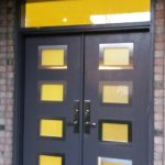 Modern Exterior Door with 8 door lites and stainless steel frams with Transom installed in Kong City, Ontario by modern-doors.ca-Front View