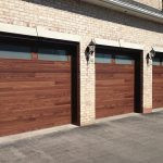 Modern Woodgrain Garage Doors with 2 Frosted WIndows Installed by Giant Doors in Oakville