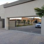 Modern_Garage_Doors_Custom__Aluminum_frame_with_mirror_glazing_full_Privacy.