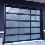 Oversized Aluminum Frosted Glass Garage Door in Custom Home in Oakville by Modern Doors