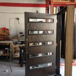 Woodgrain Modern Front Door with 5 Door Lites and Multi Point Locks During Manufacturing by Giant Doors