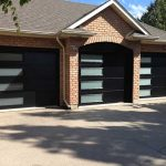 Modern Garage Doors with Frosted Side lites installed in Oakville by Modern Doors