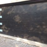 Fiberglass Modern Woodgrain Garage Doors-Fiberglass Woodgrain Modern Garage door with frosted door lites manufactured and installed by modern-doors in Richmond Hill