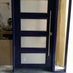Fiberglass Front Door-Modern Fiberglass Smoth Front Door With 4 Frosted Door Lites and Side lite During Manufacturing by Modern Doors