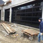 Modern Aluminum Garage Doors-Clear Glass Garage Doors During Installation by Modern Doors