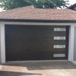 Modern Fiberglass Garage Woodgrain Door with 4 Frosted Door Lite installed by Modern Doors