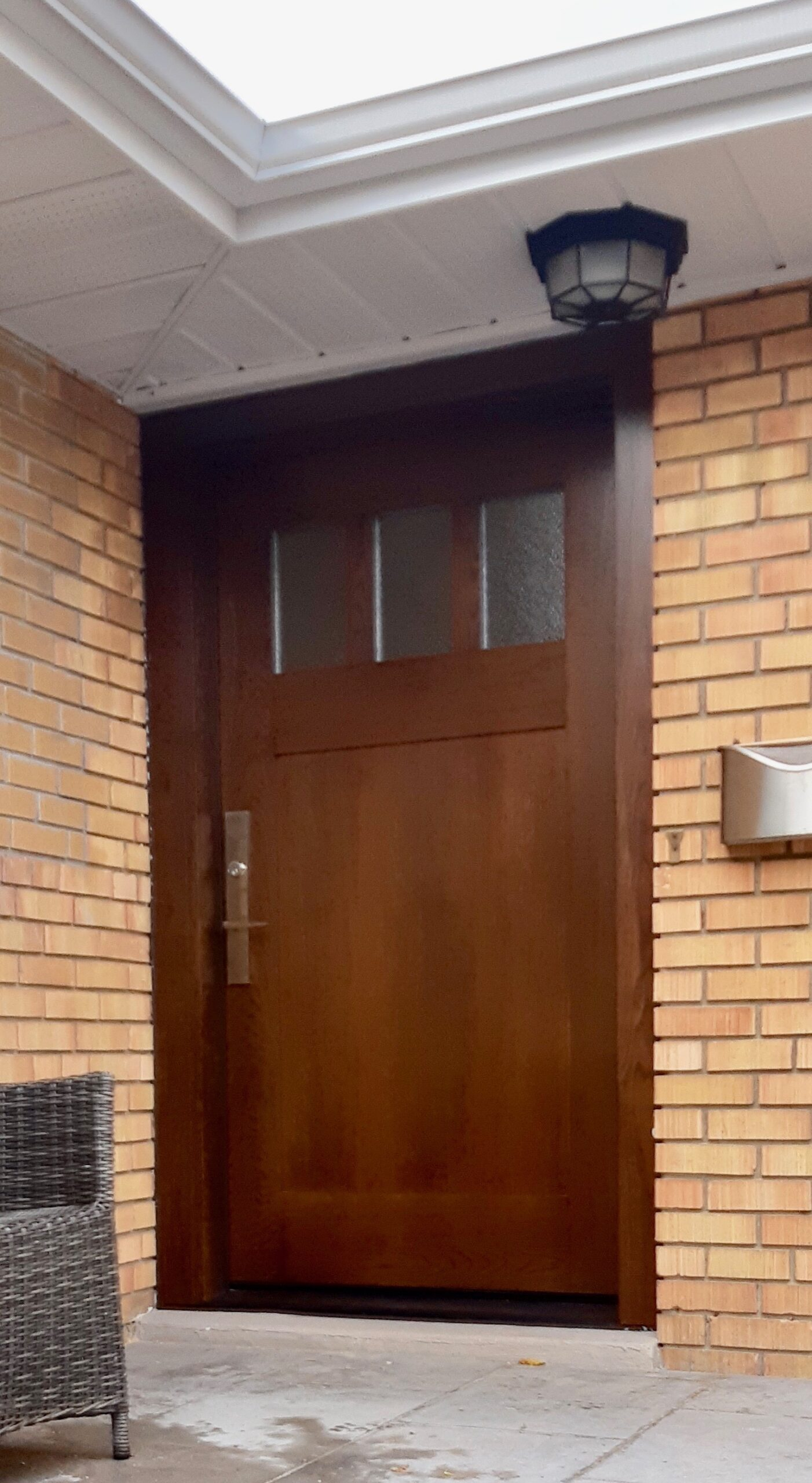 Traditional single front entry door Wood Grain Finish