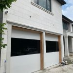 White Aluminum Panels With Black Glass Garage Doors