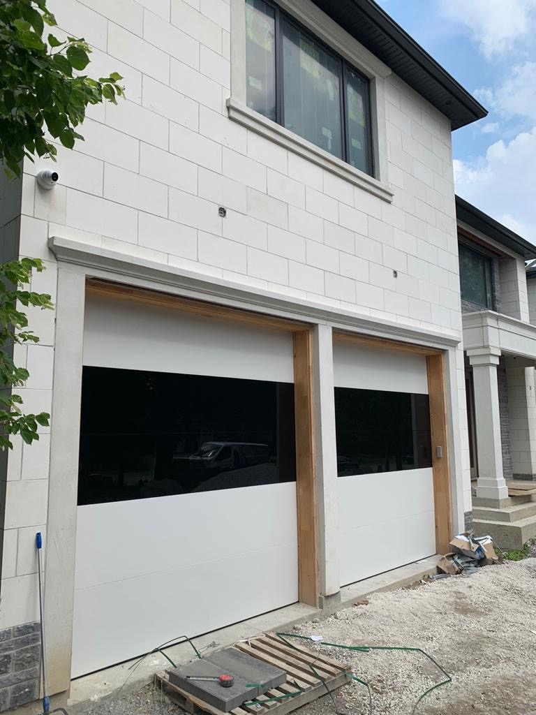 White Aluminum Panels With Black Glass Garage Doors