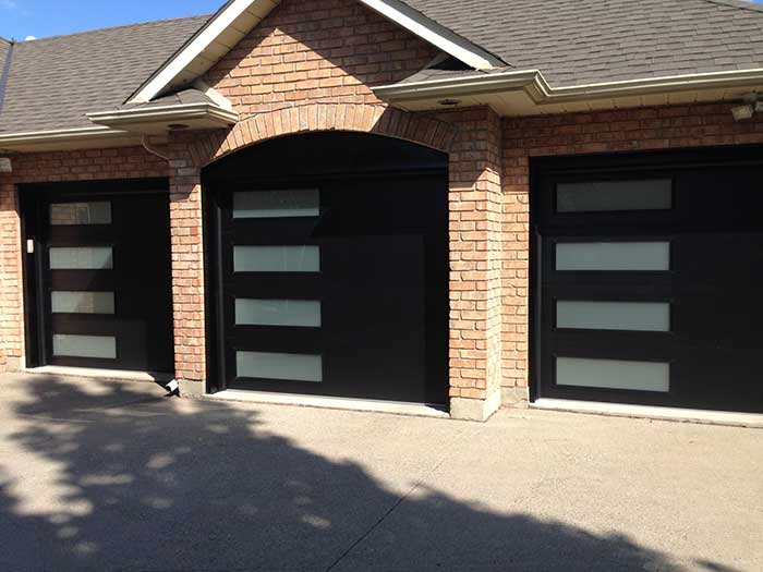 3 Modern Garage Doors with Frosted Side lites installed in Oakville by Modern Doors