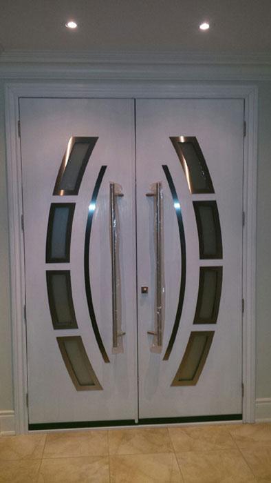 Custom Design Modern Doors with Arched Designed door lites and stainless steel door handles-Inside View