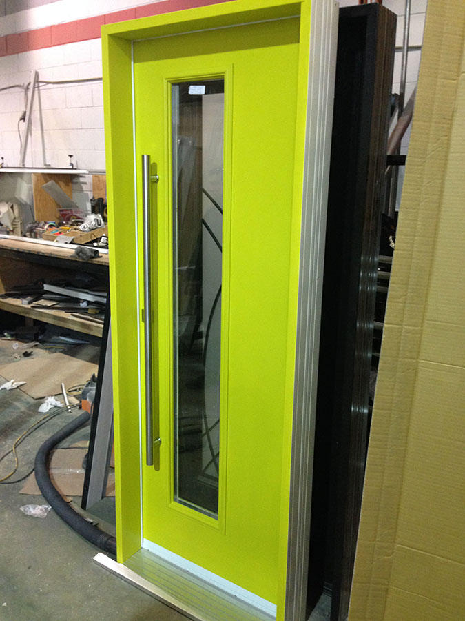 Fiberglass Door-Modern Fiberglass Exterior door with green neon color and stainless steel handle manufactured by Modern Doors