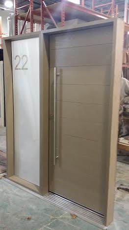 Fiberglass Door-Modern Rustic Door beige color with Frosted Glass Side Lite & Stainless Steel Handle During Manufacturing by modern-doors.ca