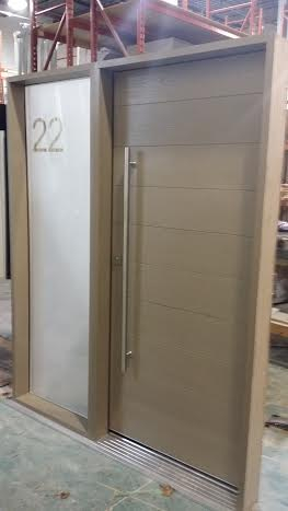 Fiberglass Door-Modern Rustic Door with Frosted Glass Side Lite & Stainless Steel Handle During Manufacturing by modern-doors.ca