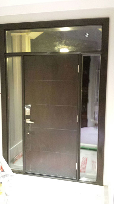 Fiberglass Doors-Modern Woodgrain Fiberglass Door with Multipoint Locks and 2 Clear Side Lites and Transom Installed in Scarborough