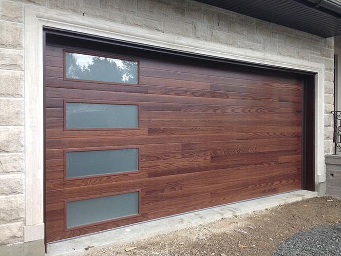 Fiberglass Garage Doors-Fiberglass Woodgrain Modern Garage door with frosted door lites manufactured and installed by modern-doors