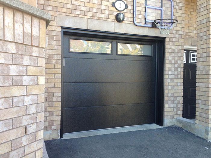 Fiberglass Garage Doors-Modern Garage door with frosted door lites manufactured and installed by modern-doors.ca
