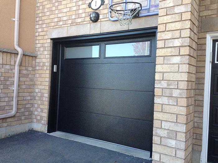 Fiberglass Garage Doors-Modern Garage door with frosted door lites manufactured and installed in Woodbridge by modern-doors