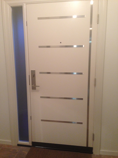 Fiberglass Modern Door with Stainless Steel strips and frosetd side lite installed in Richmond Hill by Modern Doors