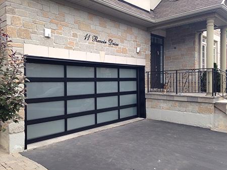 Fiberglass Modern Garage Door with Frosted Door Lites instaled in Oakville