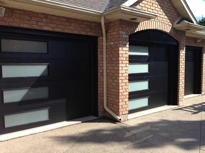 Fiberglass Modern Garage Doors with Frosted Side lites installed in Oakville by Modern Doors