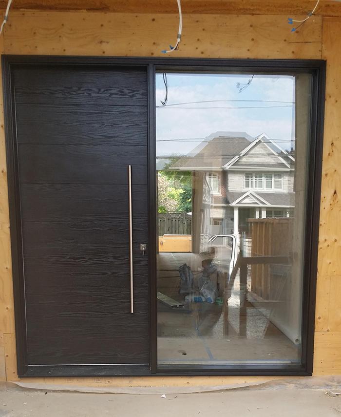 Fiberglass Woodgrain Single Modern Door with Clear Glass Door Lite installed by Modern Doors