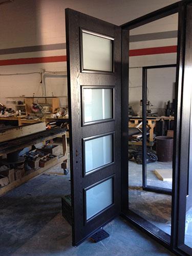 Front Entry Door-Modern Door-Modern Fiberglass Door with 4 Door Lites and 2 Frosted Side Lites Durng Installation by modern-doors.ca