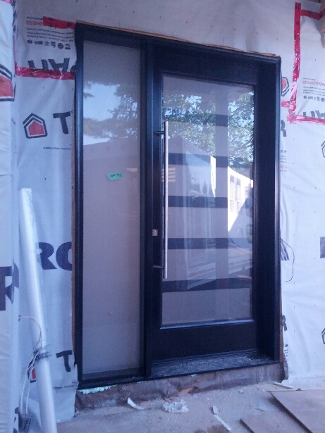 Front Single Over Sized Modern Contemporary Door System installed in Custom Home in Oakville
