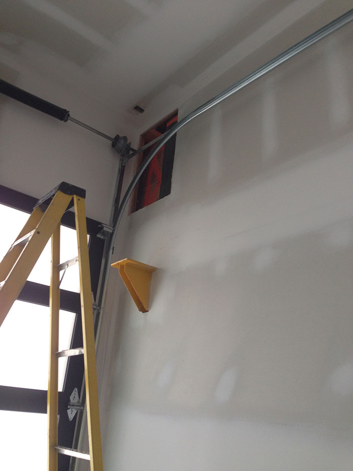 Installation of a Garage Door with a Side Motor by Modern Doors