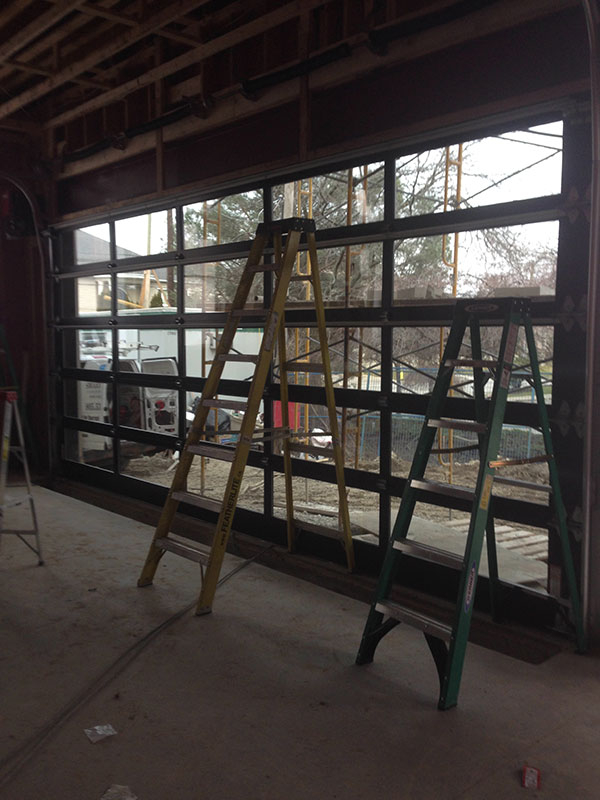 Modern ALuminum Garage Doors with Clear Glass During Installation by Modern Doors-Inside View
