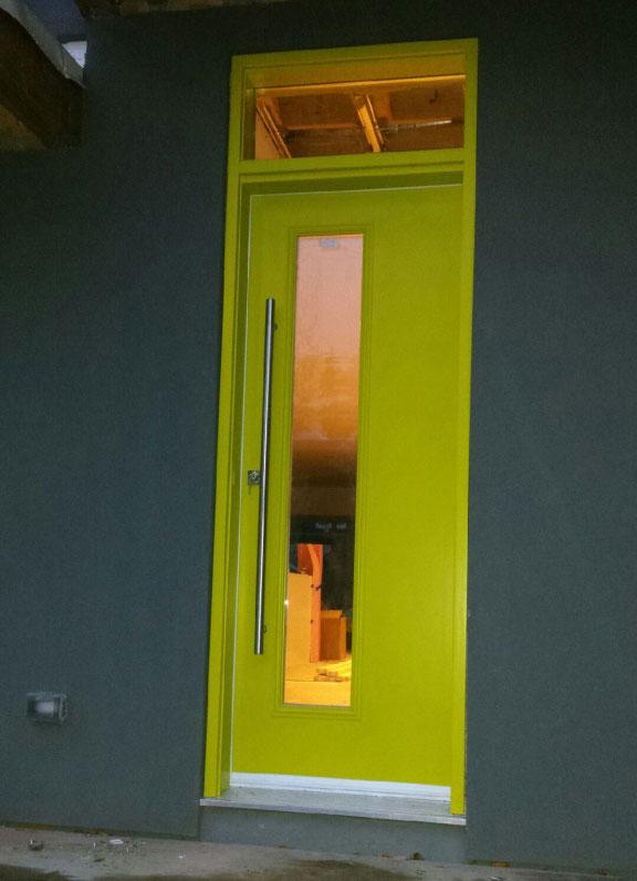 Modern Custom Fiberglass Door with Door Lite and Transom installed in Modern Home
