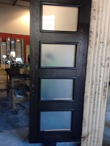 Modern Door-Front Entry Door-Modern Fiberglass Door with 4 Door Lites and 2 Frosted Side Lites Durng Installation by modern-doors.ca