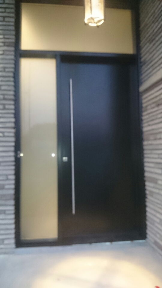 Modern Door -Modern Solid Door with side lite & transom and stainless steel handle installed in Oakville by modern-doors.ca
