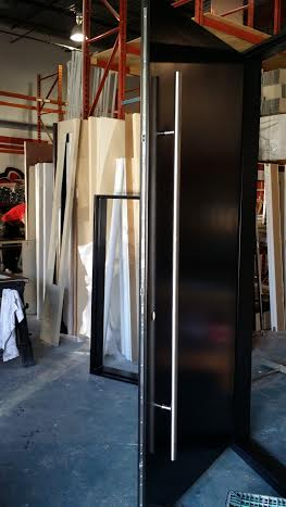 Modern Door -Modern Solid Fiberglass Door with stainless steel handle during manufacturing by modern-doors.ca