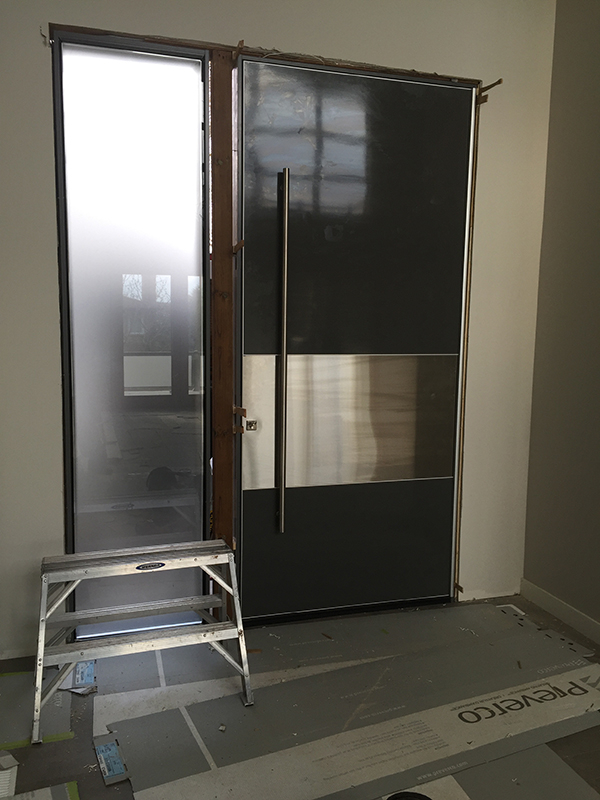 Modern Exterior 10 feet Door with Stainless Steel bar during installation in Vaughan-Inside View